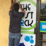 Custom Window Graphics installation for The Lost Sock Laundromat