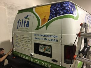 Van wrap installation at Miami Custom Signs & Wraps
